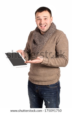 Young modern man presenting his new and cool tablet pad. Isolated on white background. Emotional man shows what pure electronic tablet. Joyful man with a smile on his face. Space for text. - stock photo