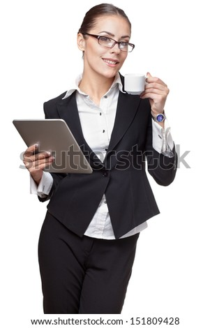 young modern professional businesswoman holding tablet pc and cup of coffee - stock photo