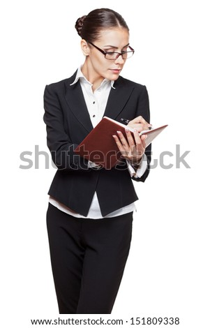 young modern professional businesswoman making entries in the diary