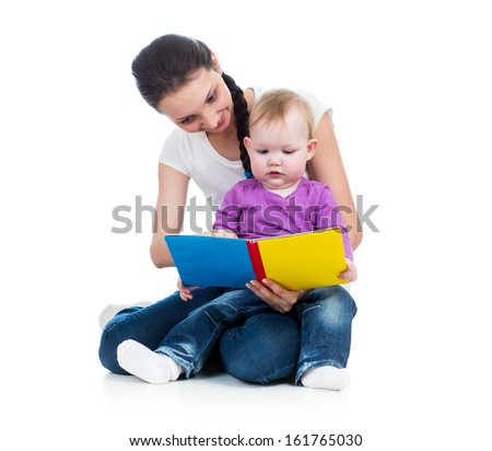 young mom reading a book to her baby - stock photo