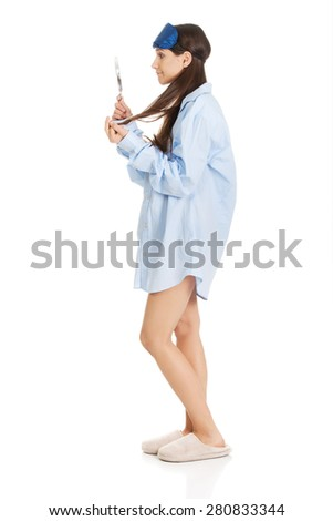 Young morning woman in big shirt and mirror. - stock photo