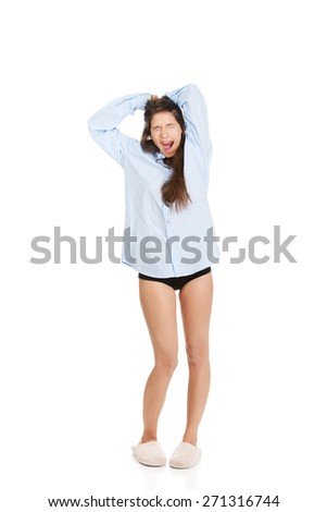 Young morning woman in big shirt and slippers. - stock photo