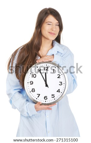 Young morning woman in big shirt holding clock. - stock photo