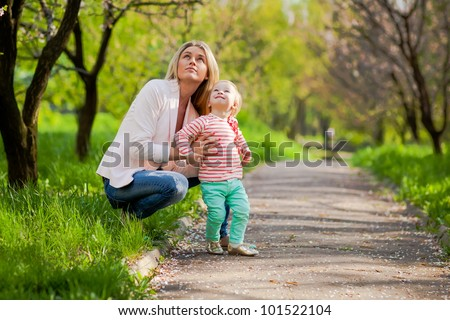 Young mother and daughter on nature background - stock photo