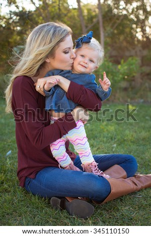 Young mother and daughter outside together