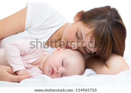 Young mother and her baby sleeping together - stock photo