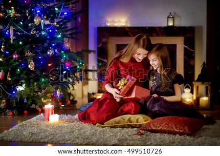 Young Mother Her Daughter Unwrapping Christmas Stock Photo (Royalty ...
