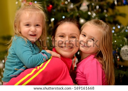 Young mother and her daughters on Christmas