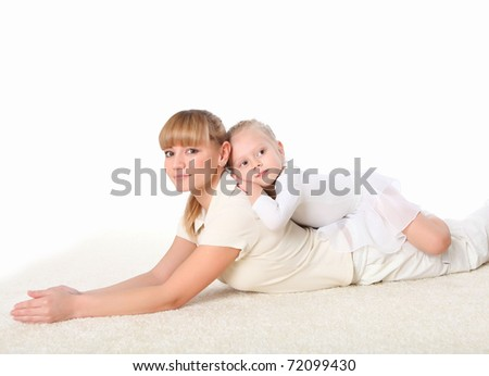 young mother and her little daughter doing sport together indoors