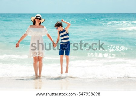 Young mother and her son at Thai beach, Koh Phangan island, Thailand, Asia