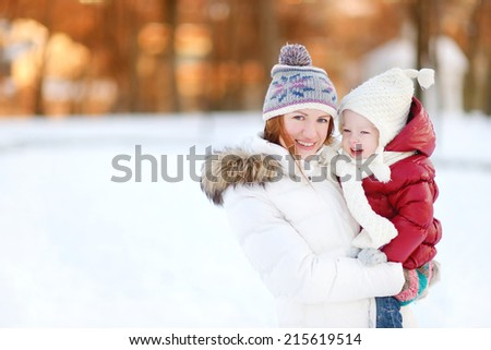 Young mother and her toddler daughter on a winter day
