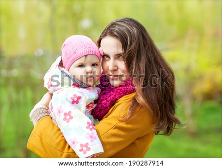 Young mother and her toddler girl have fun