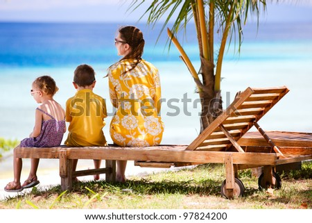 Young mother and her two kids enjoying ocean view