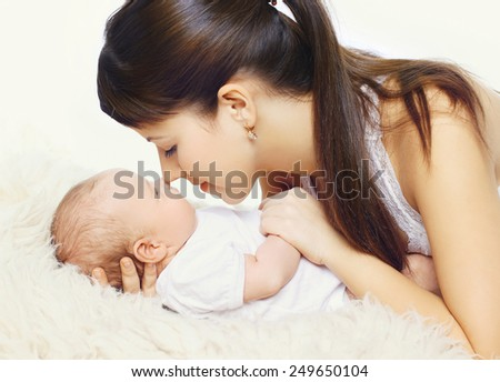 Young mother and infant togetherness - stock photo