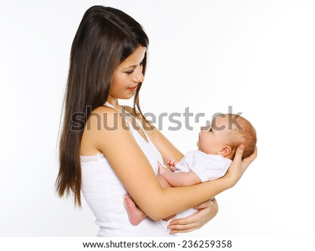 Young mother and little baby - stock photo