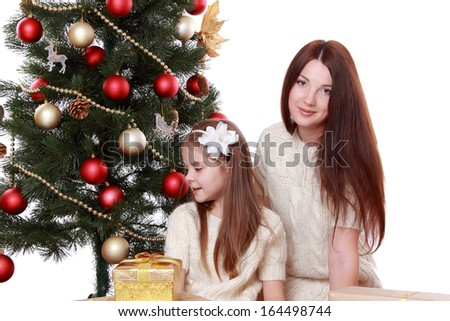 young mother and lovely little girl having fun time on Christmas time/Happy mother and daughter on Holiday theme - stock photo