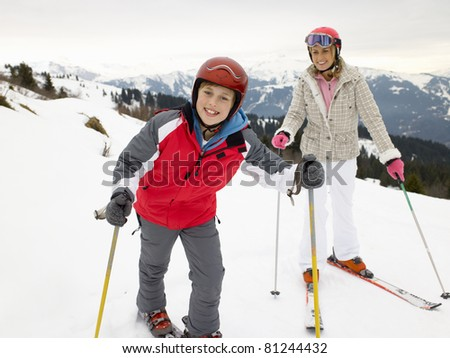 Young Mother And Son On Ski Vacation - stock photo