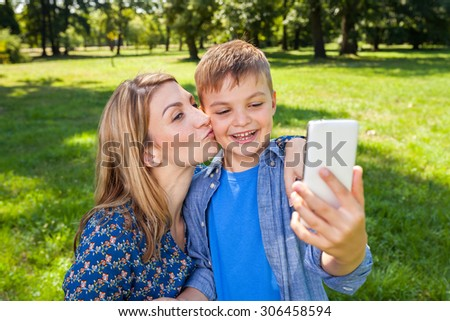young mother and son taking a picture of them self - stock photo