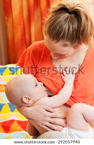 Young mother breastfeeds her baby. Breast-feeding. - stock photo