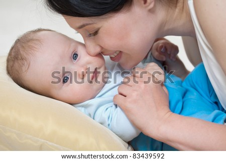young mother caressing her first child