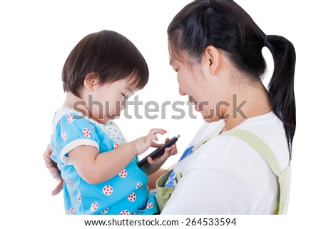 Young mother carrying her daughter, adorable little asian (thai) girl holding and playing electronic gadget (Child Development and Learning) ,isolated on white background - stock photo