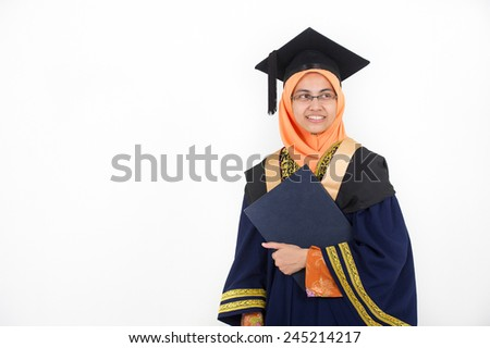 Young mother college graduate holding degree after convocation ceremony.