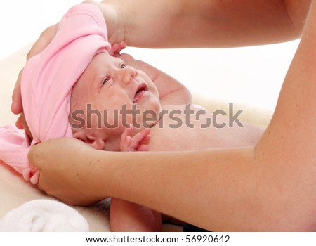 Young mother dressing of her to daughter. - stock photo