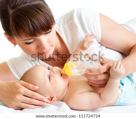 young mother feeding her adorable baby - stock photo