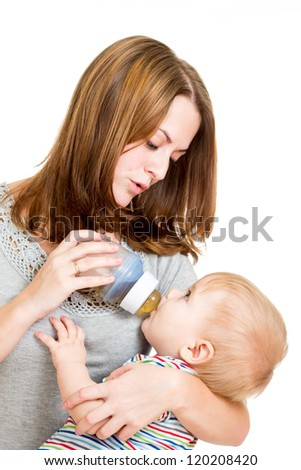 young mother feeding her adorable baby boy - stock photo