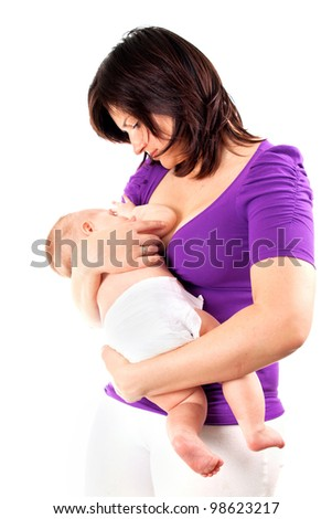 Young mother feeding her baby with breast