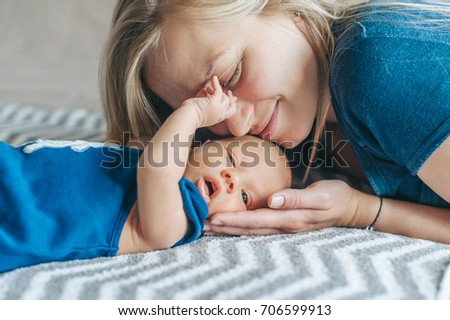 Young mother happy newborn child