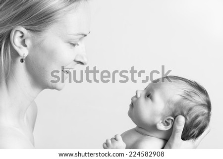 Young mother holding her baby daughter
