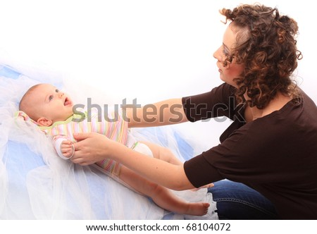 Young mother holding her baby. Mothercraft concept.