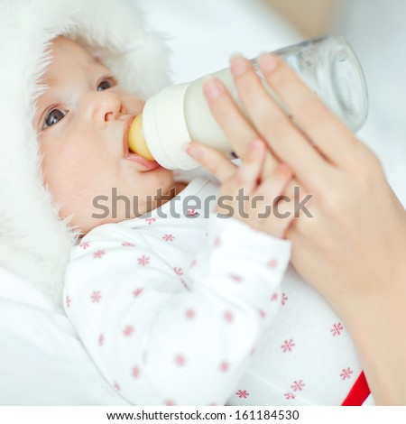 Young mother is feeding her baby