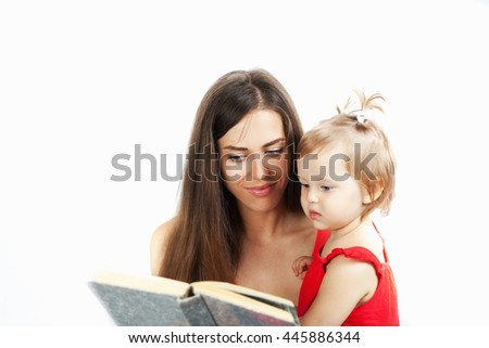 Young mother is reading a book with her daughter. White background - stock photo