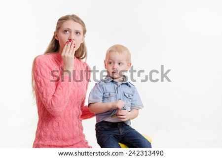 Young mother is shocked by three sons - stock photo