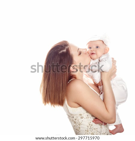 Young mother kissing firstborn. The concept of happiness in the family. - stock photo
