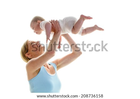 Young mother makes with her 6 month old daughter postnatal exercises, isolated against white background. She kneels on the ground and lifts the baby up and laughs.  - stock photo