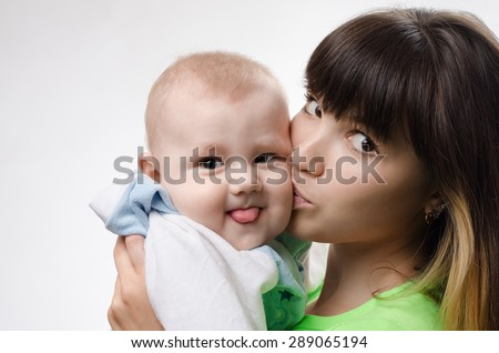 young mother playing with baby