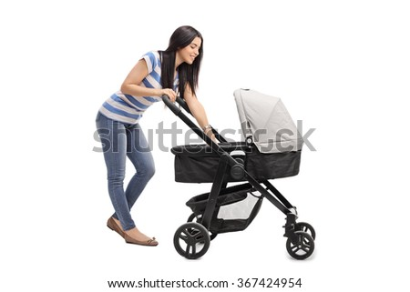 Young mother playing with her baby in a baby stroller isolated on white background - stock photo