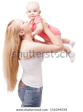 young mother playing with her baby, isolated on white background (focus on the mother) - stock photo