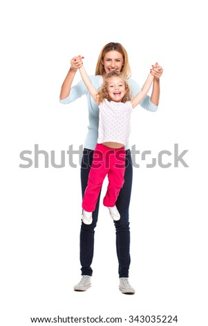 young mother playing with her little daughter isolated on white - stock photo