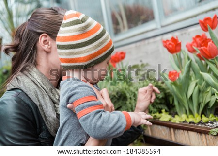 Young mother playing with her son in early Spring. - stock photo