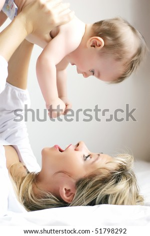 Young mother playing with son
