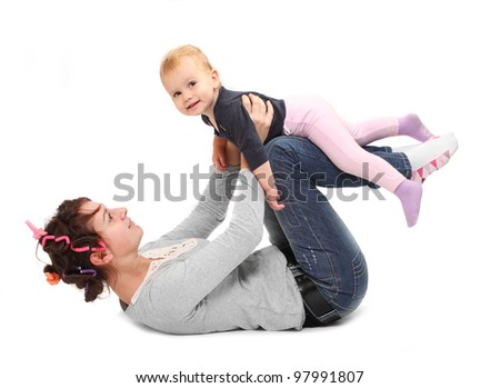 Young mother practicing with her daughter. Healthy life style concept.