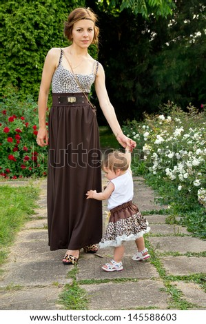 Young mother walks with the child in the street