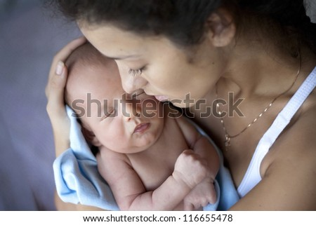 young mother with a baby - stock photo