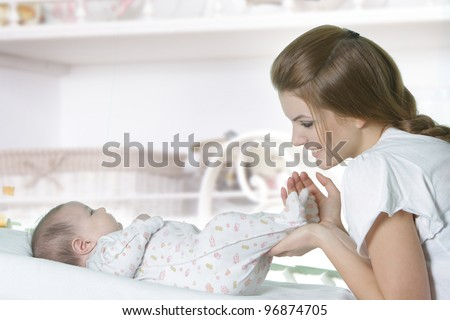 young mother with baby at home - stock photo