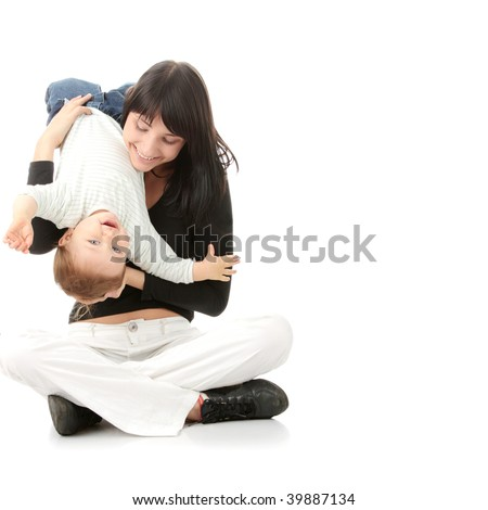 Young mother with baby girl isolated on white background