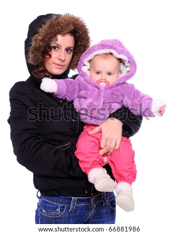 Young mother with cute baby dressed in a fur. Seasonal fashion shot. - stock photo
